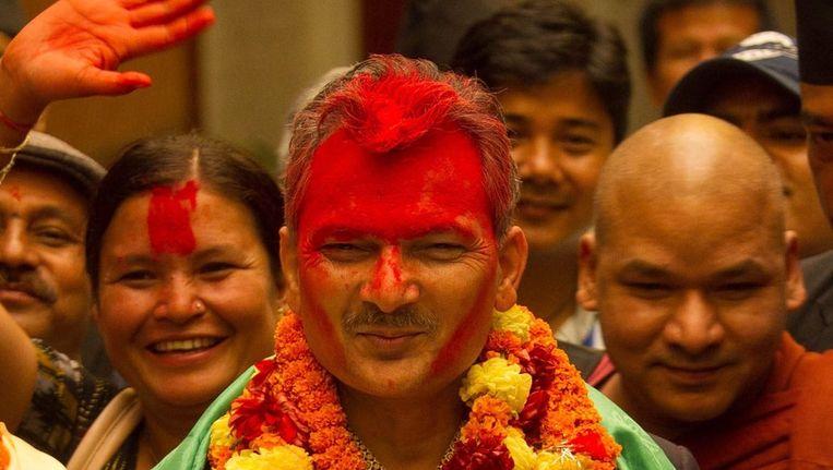 De nieuwe premier Baburam Bhattarai viert zijn overwinning. Beeld epa
