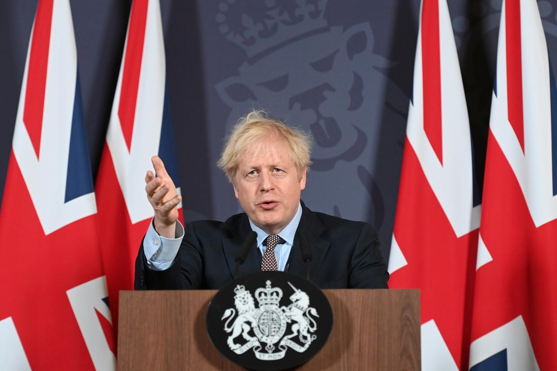 Boris Johnson tijdens de persconferentie in Downing Steet, waar hij de uitkomst van de onderhandelingen bekendmaakte.  Beeld REUTERS