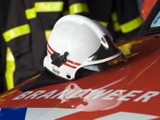 Huizen ontruimd bij brand in een portiekflat