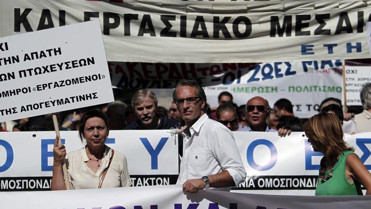 Griekse journalisten bij een eerdere staking. Beeld EPA
