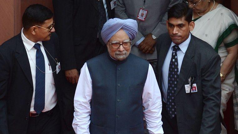 De Indiase premier Manmohan Singh (midden) Beeld afp