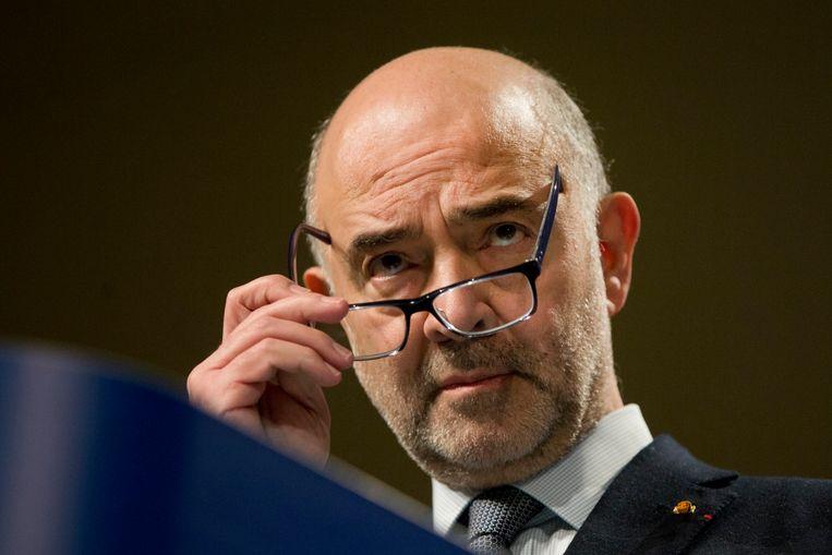 Commissaris Pierre Moscovici is naar eigen zeggen blij met het akkoord. Beeld AP