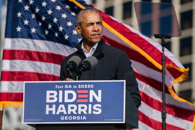 De Amerikaanse president Barack Obama tijdens een campagne voor nu president-elect Joe Biden en vicepresident-elect Kamala Harris. Beeld REUTERS