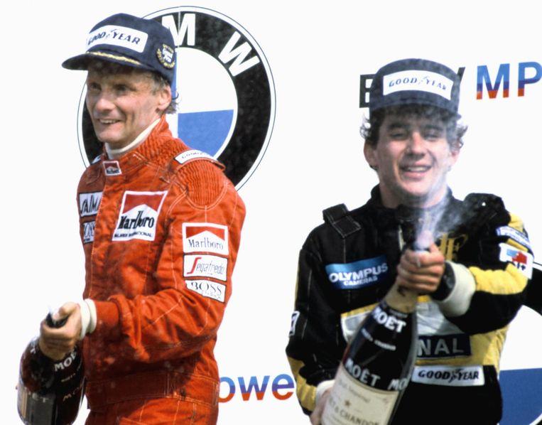 Niki Lauda, die de Formule 1 van Zandvoort in 1985 won, daarnaast de Braziliaan Ayrton Senna. Beeld anp