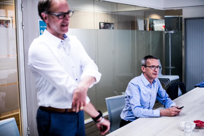 Rectoren Rik Van De Walle en Luc Sels  Beeld Bas Bogaerts