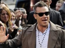 Robbie Williams en Meat Loaf jagen op UFO's