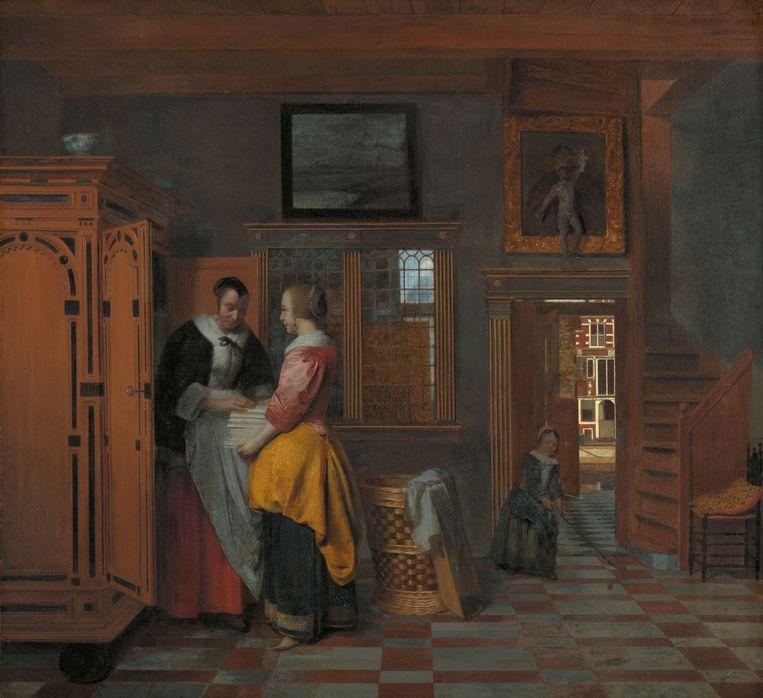 Binnenhuis met vrouwen bij een linnenkast, Pieter de Hooch (1663). Beeld Rijksmuseum