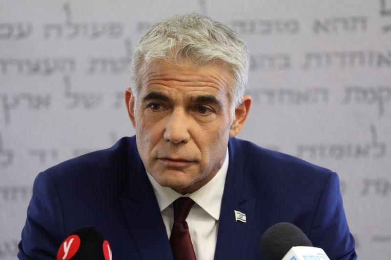 Yair Lapid, formateur en leider van de centristische partij Yesh Atid, zegt dat de coalitie zal proberen 'een verscheurde natie' weer te helen.  Beeld EPA