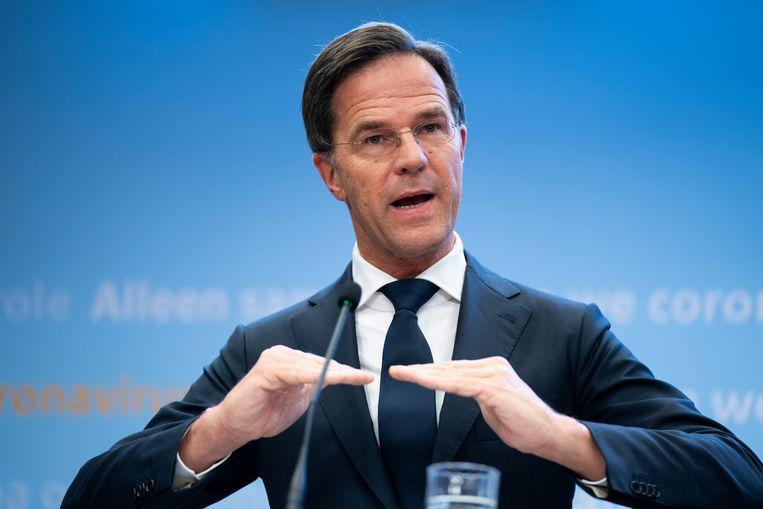 Premier Mark Rutte en minister Hugo de Jonge (Volksgezondheid, Welzijn en Sport) geven een toelichting op de aanscherping van de coronamaatregelen in Nederland. Beeld Hollandse Hoogte /  ANP