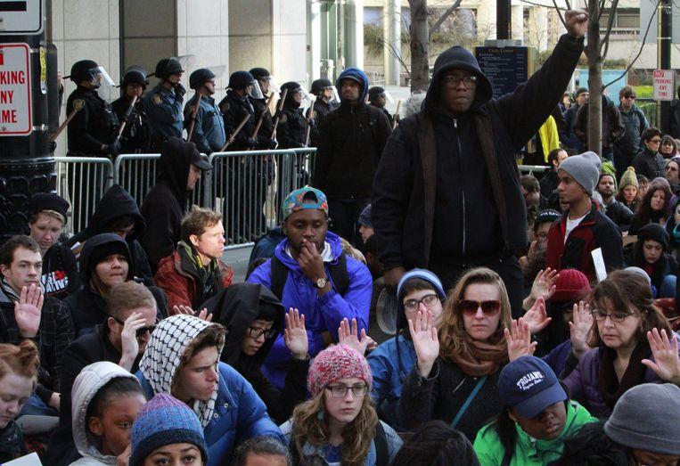 Demonstranten in Seattle houden een sit-in. Beeld ap