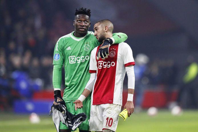 André Onana en Hakim Ziyech vieren de winst op PSV.