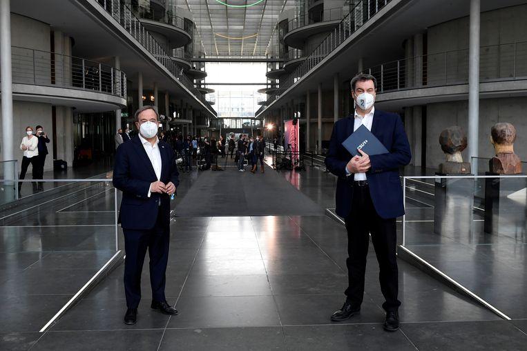 Armin Laschet (l) en Markus Soder (r). Beeld REUTERS