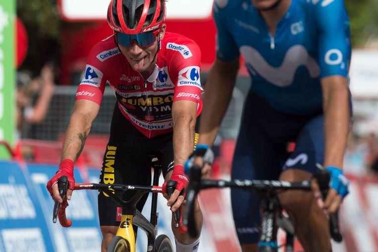 Primoz Roglic passeert de finish in Rincon de la Victoria. Beeld AFP