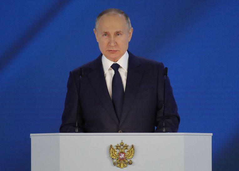 De Russische president Vladimir Poetin tijdens zijn traditionele jaarrede op 21 april 2021. Beeld AFP