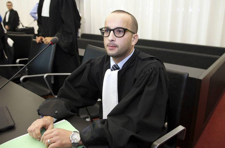 Abderrahim Lahlali, advocaat van de families: 'We gaan een deurwaarder vragen de dwangsommen te innen.'  Beeld belga