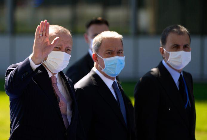 Turks president Recep Tayyip Erdogan (links) bij zijn aankomst.