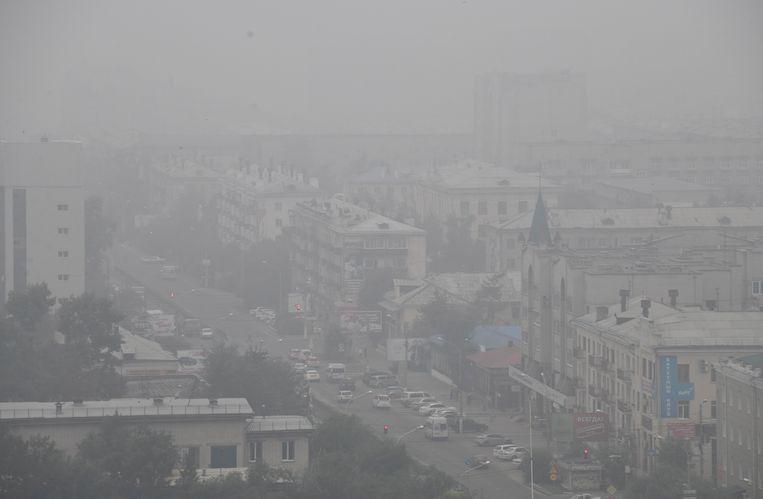 Rook in de straten van Chita, een stad in het oosten van Siberië. Beeld AP