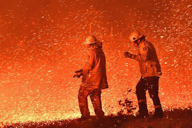 Meerdere dorpen gingen in vlammen op. Beeld AFP