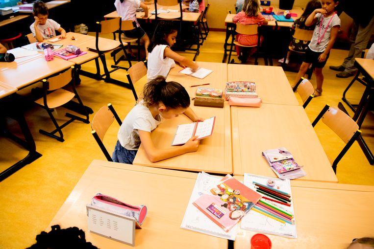 Regeringspartij N-VA vraagt om het M-decreet, waardoor leerlingen met specifieke zorgnoden zich kunnen inschrijven in het gewoon onderwijs, bij te schaven. Beeld Belga