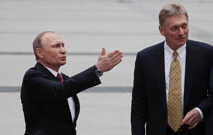 Vladimir Poutine et le porte-parole de la présidence russe, Dmitri Peskov