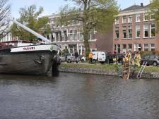 Roeiers te water na aanvaring tussen vrachtschip en roeiboot in Voorburg