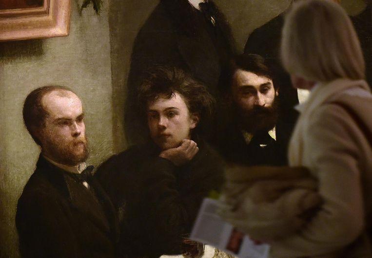 Paul Verlaine (links) en Arthur Rimbaud (rechts) op een schilderij van Henri Fantin-Latour uit 1872. Beeld afp