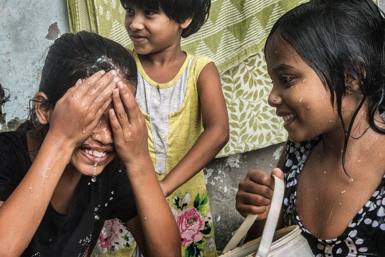 Indiase kinderen in Kolkata. Beeld BELGAIMAGE