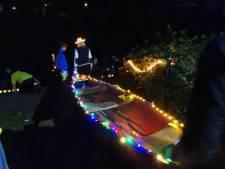 Boxtel by Night met fraai verlichte kano's