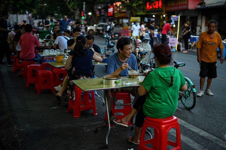 Het leven van de inwoners van Wuhan is grotendeels teruggekeerd naar normaal. Beeld AFP