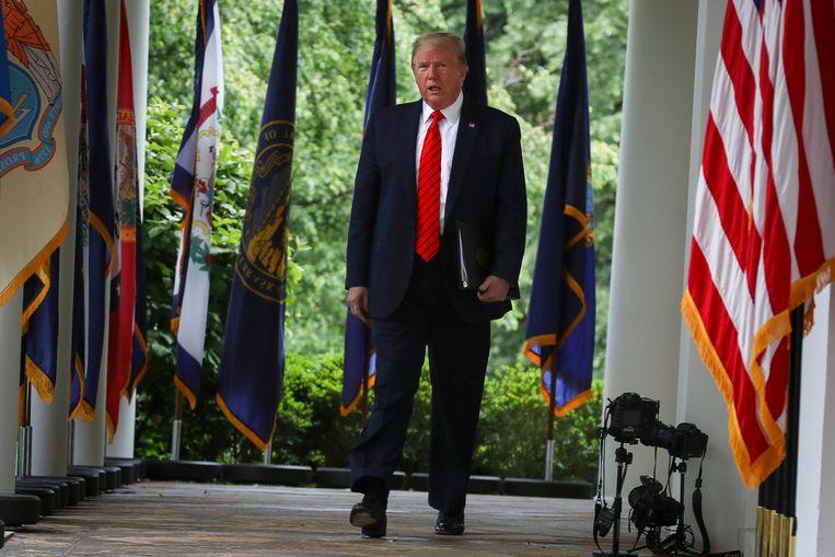 De Amerikaanse president Donald Trump verliet de persconferentie abrupt na een confrontatie met een journaliste.  Beeld Photo News