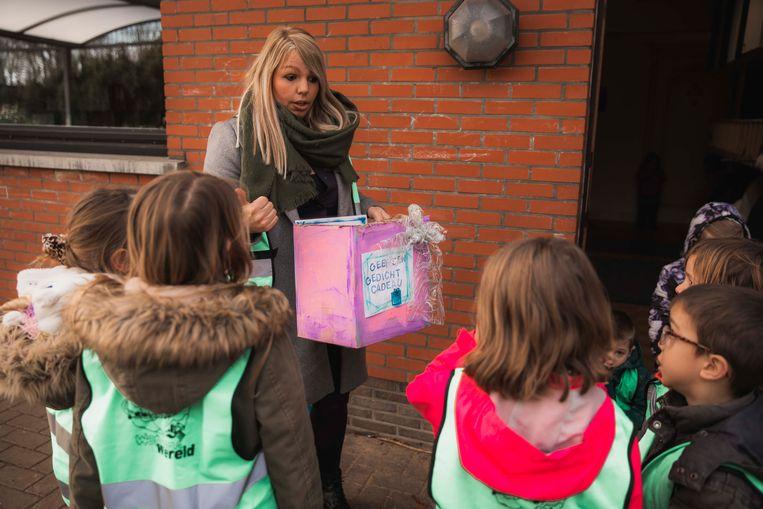 De kinderen gingen gedichtjes voorlezen aan de handelaars van Lummen.