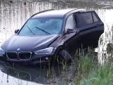 Auto te water in Rosmalen, bestuurder nergens te bekennen