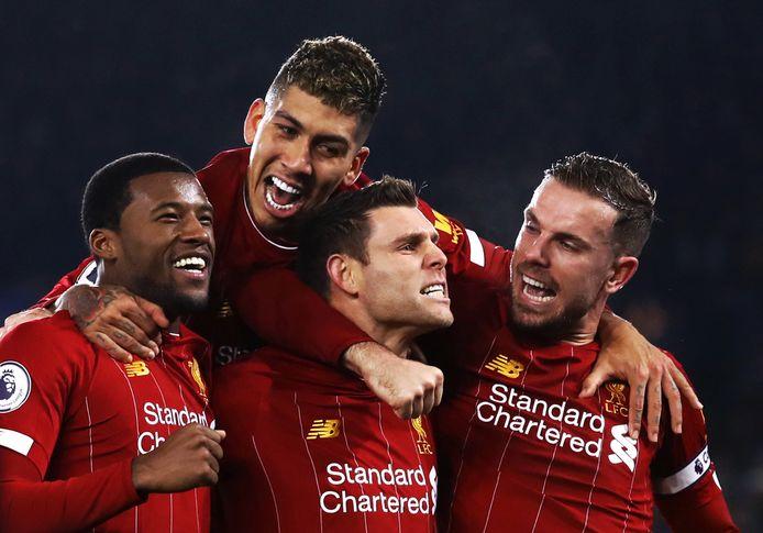 Wijnaldum, Firmino, Milner en Henderson juichen.