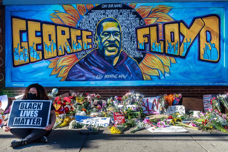 Een muurschildering ter herdenking aan George Floyd. Beeld AFP