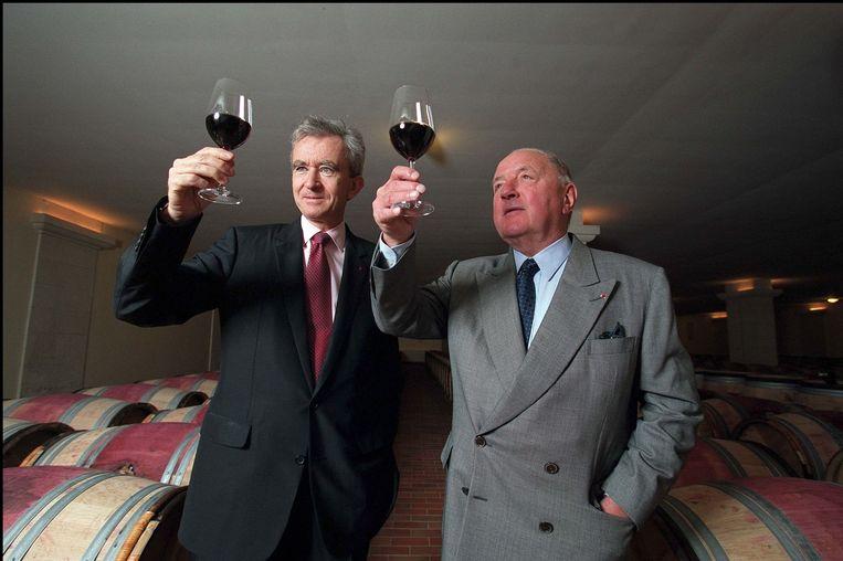Bernard Arnault en Albert Frère in Château Cheval Blanc. Beeld Photo News