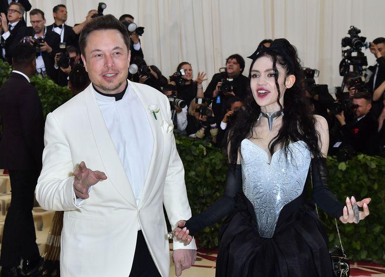 Elon Musk en zijn vriendin Grimes. De twee hebben een kind genaamd X Æ A-12. Beeld AFP