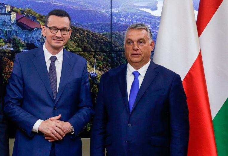 Pools premier Mateusz Morawiecki en Hongaars premier Viktor Orbán. Beeld AFP