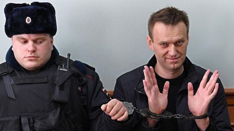 De Russische oppositieleider Aleksej Navalny tijdens een hoorzitting in Moskou op 30 maart 2017.  Beeld AFP