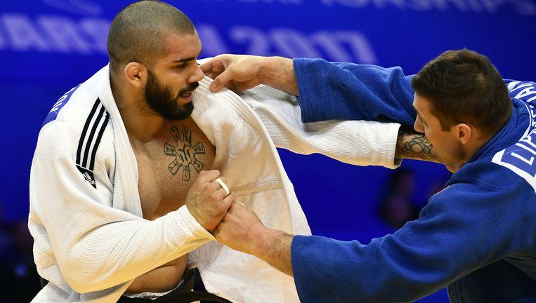 Nikiforov in actie vorig jaar in de voor hem desastreus verlopen Spelen in Rio. Beeld BELGA