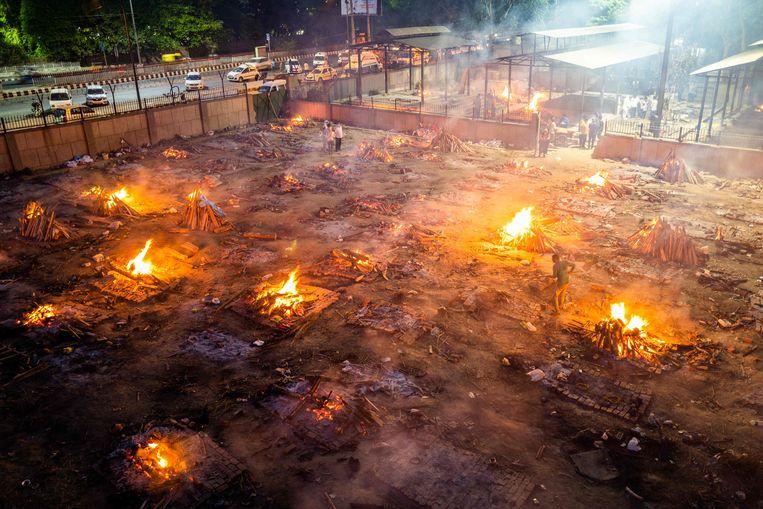 Een crematieplek in New Delhi, 26 april 2021. Beeld AFP