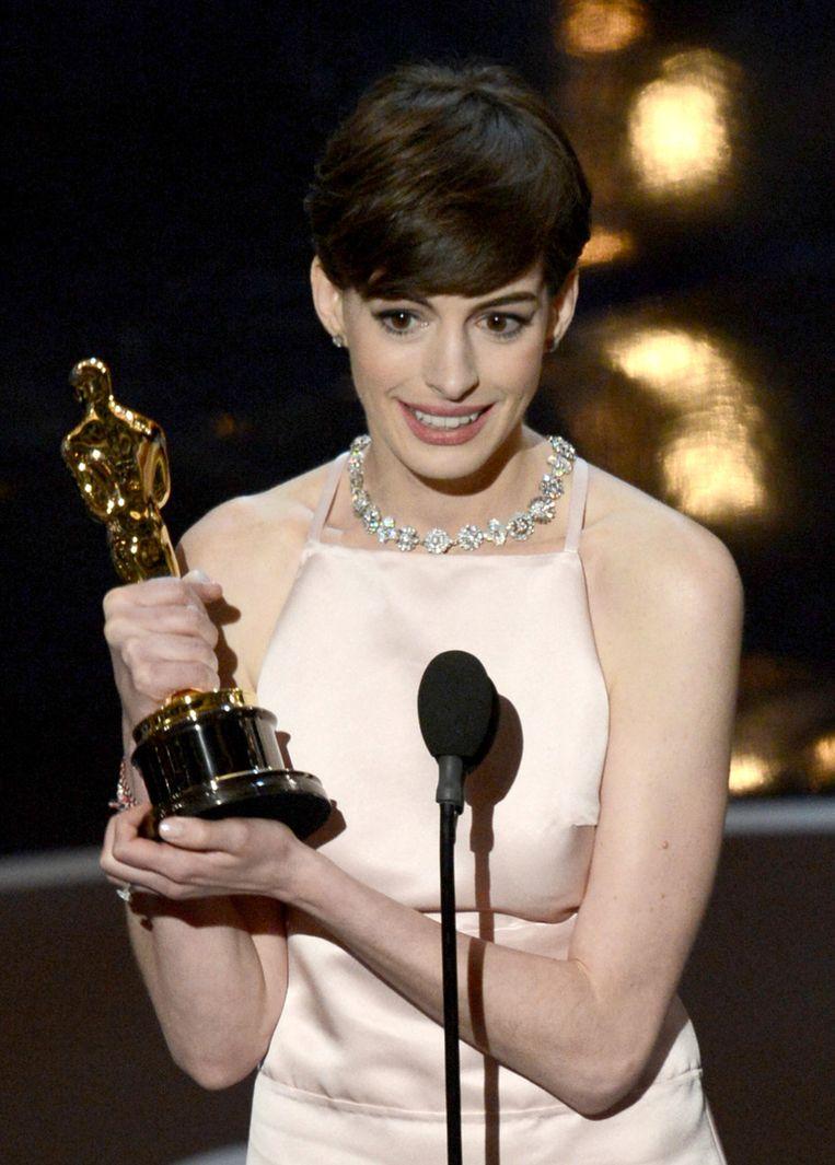Anne Hathaway (Beste Vrouwelijke Bijrol) voor Les Misérables. Beeld AFP