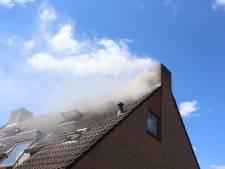 Veel rookschade door brandende zolder bij woning in Best, bewoners veilig buiten