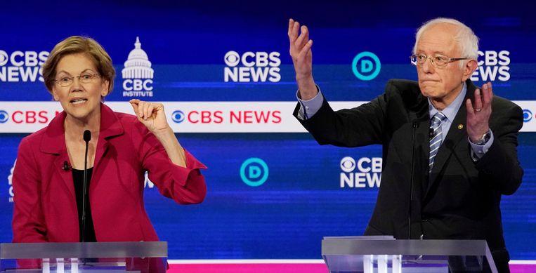 Elizabeth Warren en Bernie Sanders tijdens een debat eind vorige maand. Beeld REUTERS