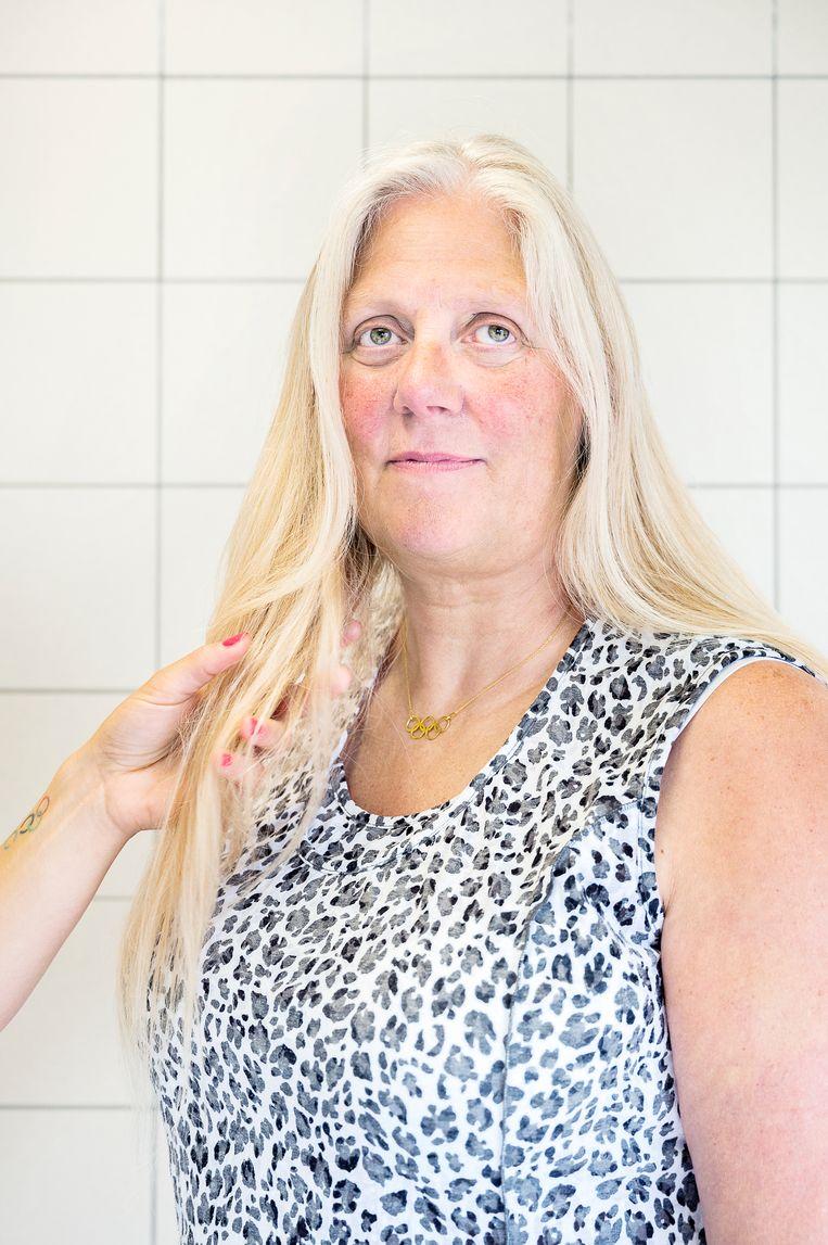 Jolanda de Rover draagt een gouden kettinkje met de vijf olympische ringen. Beeld Sanne De Wilde
