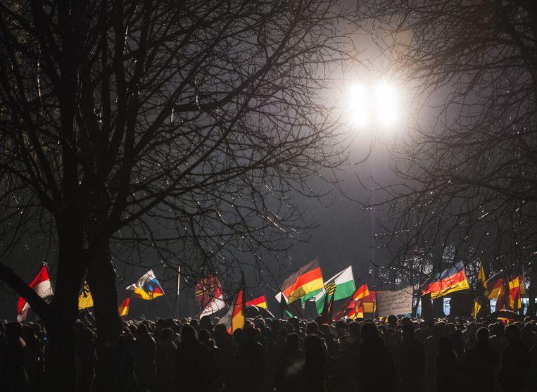 Pegida-demonstranten in Dresden, op maandag 5 januari. Beeld ap