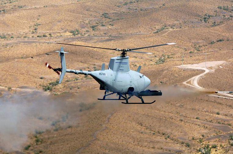Een helikopterdrone patrouilleert boven Libië (2011). Binnenkort wil het Amerikaanse leger zo ver zijn dat robotwapens standaard als verkenners voor militairen uittrekken. Beeld AFP