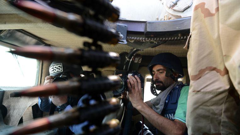 Een Koerdische peshmerga-strijder Beeld getty