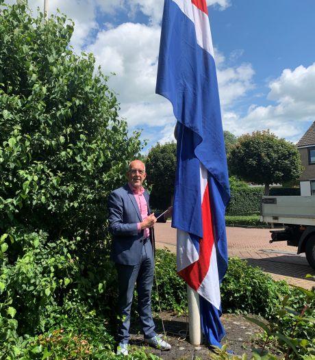 Vlag wappert in Hasselt voor olympische medaillewinnaars Van der Breggen en Metsemakers