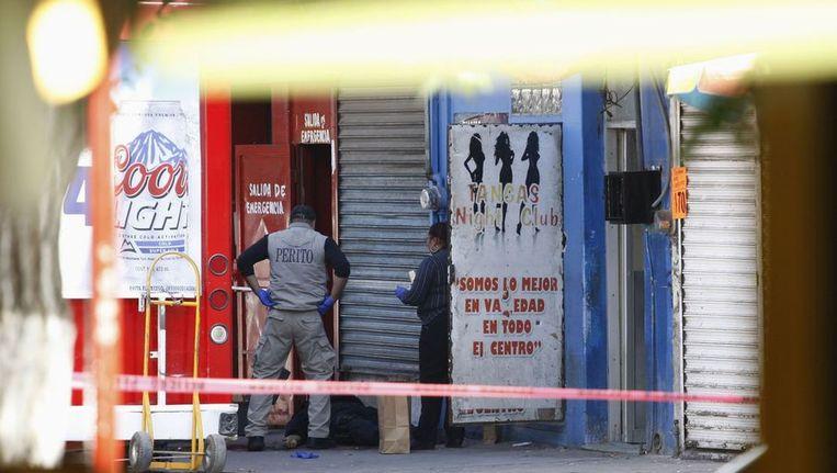 De mysterieuze moorden vonden plaats in het door geweld geteisterde Ciudad Juarez. Bendes vermoordden daar vorige maand nog minstens vier politiemannen. Beeld REUTERS