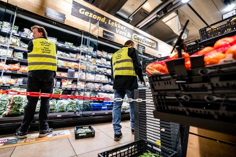 Een afgesloten gang voor het vakkenvullen in een Jumbo supermarkt.  Beeld ANP